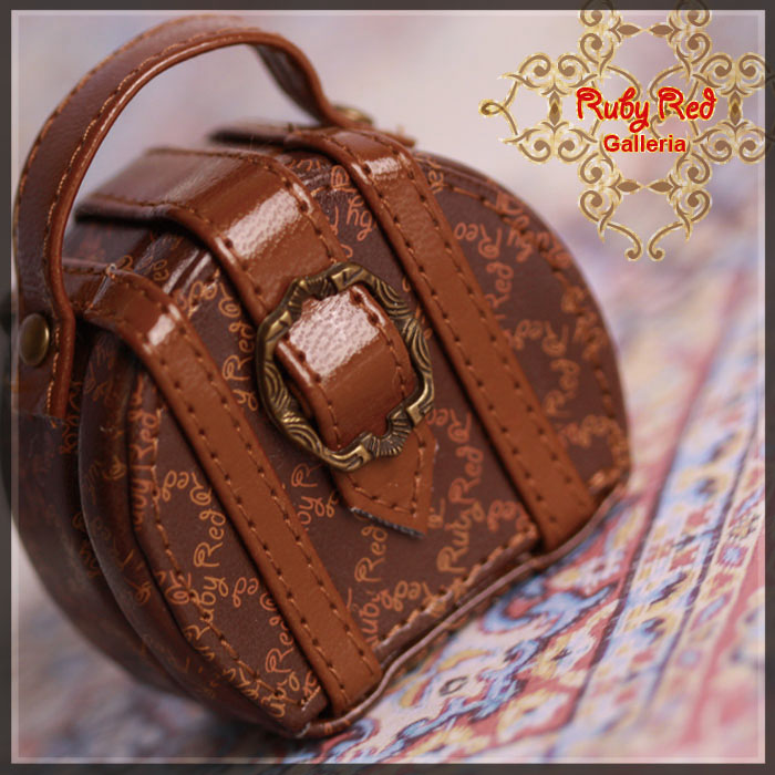 RB0024A Circular Brown Suitcase