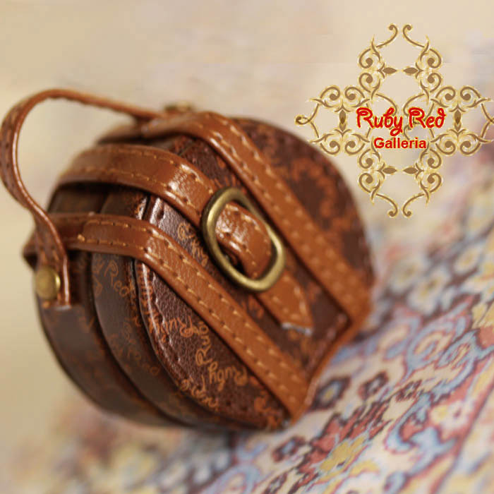 RB0025A Small Circular Brown Suitcase